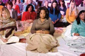 Oprah Winfrey doing Yoga