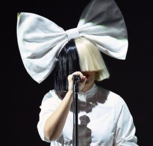 Sia Furler covered face during stage show