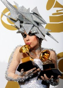 Lady Gaga with Grammy Awards