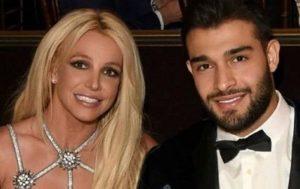 Sam Asghari with his girlfriend
