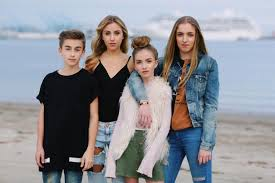 Johnny Orlando with his sisters