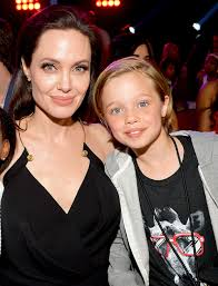 Shiloh Jolie-Pitt with her mother