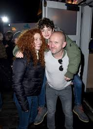 Noah Jupe with his parents