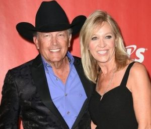 George Strait with his wife