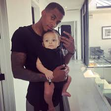 Dana Isaiah with his son