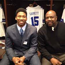 Myles Garrett with his father