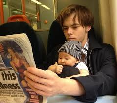 Charlie Heaton with his son