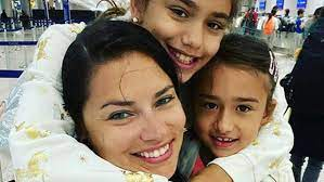 Adriana Lima with her daughters
