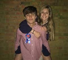 Luke Singletary with his sister