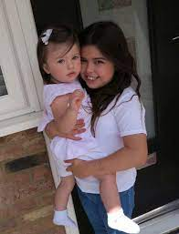 Sophia Grace Brownlee with her sister Belle