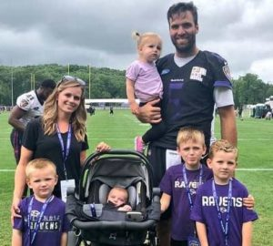 Joe Flacco with his wife & kids