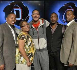 Derrick Rose with his mother & brothers