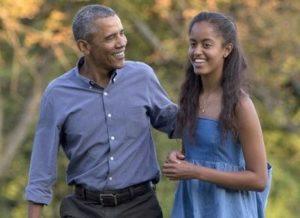 Malia Obama with her father