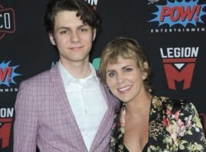 Ty Simpkins with his mother
