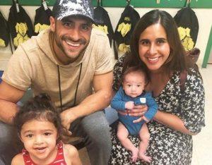 Dennis Hernandez with his children