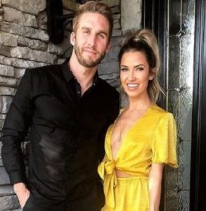 Shawn Booth with his girlfriend