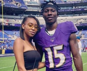 Marquise Brown with his girlfriend