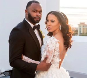 Myron Rolle with his wife