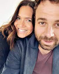 Taylor Goldsmith with his wife