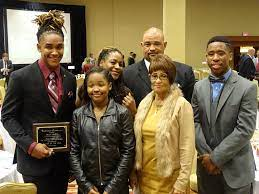 Jalen Hurts with his family