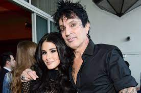 Tommy Lee with his wife Brittany