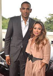 Grant Hill with his wife