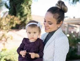 Jinger Duggar with her daughter