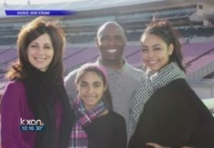 Charlie Strong with his wife & daughters